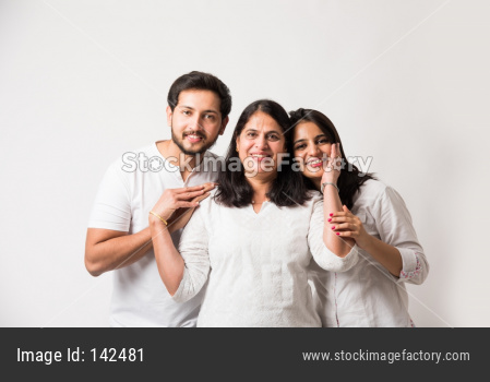 young kids with old age mother standing over white background