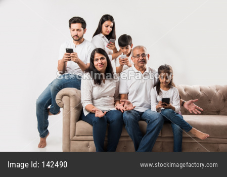 indian family using smartphone