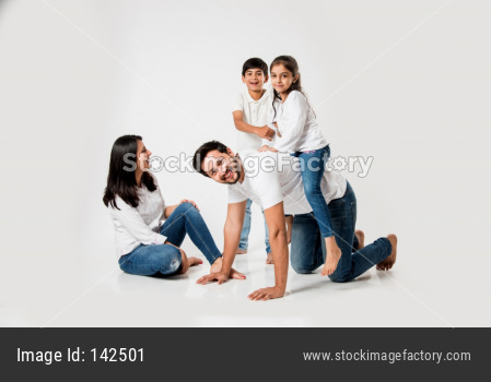 girl sitting on Dad's back while playing