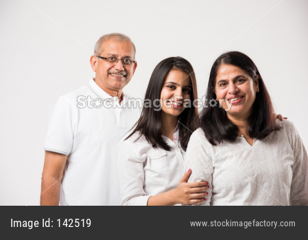 Senior Indian couple with young adult girl standing isolated over white background. selective focus