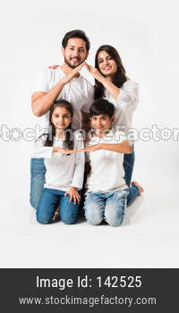 Indian family making the home sign over white background. selective focus