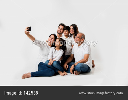 family taking selfie picture white sitting on white background