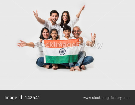 Happy Indian family holding national tricolour flag