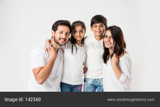 Young family of 4 standing over white