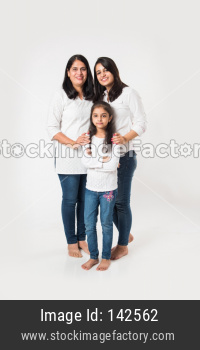 three generations of females standing isolated over white background