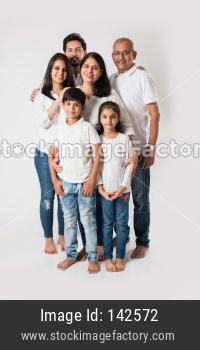 Indian family standing isolated over white background