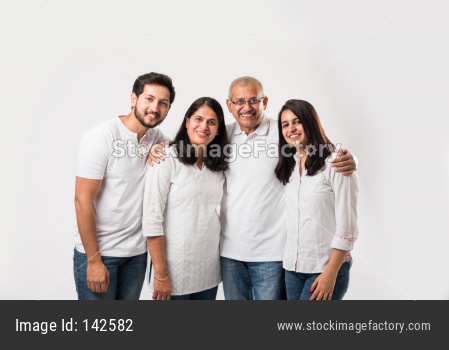 happy Indian family of 4 standing isolated over white background