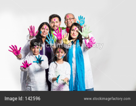 Family playing colours on Holi festival