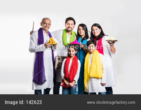 Indian Family playing holi posing for group photo over white background