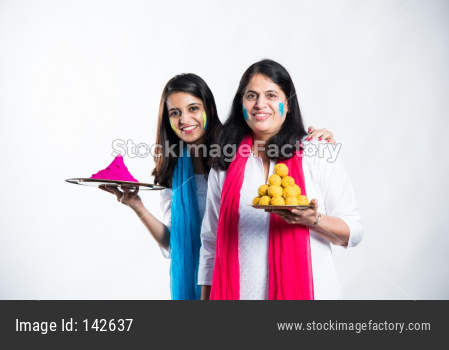 Mother and Daughter playing holi