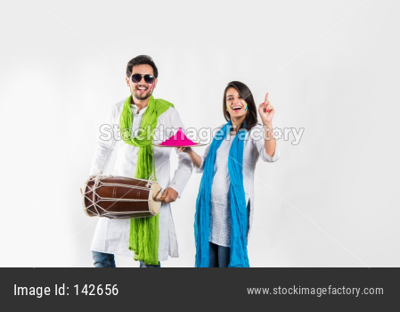 Young couple playing holi colours