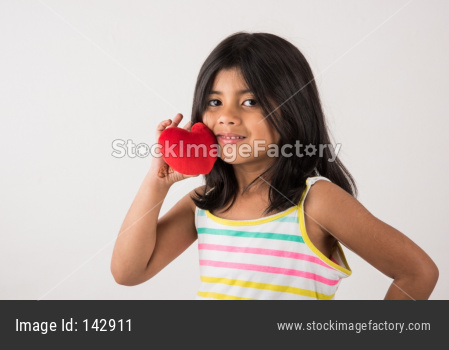 Small girl with stuffed heart toy