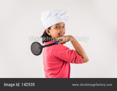 Small girl chef with hat and spatula