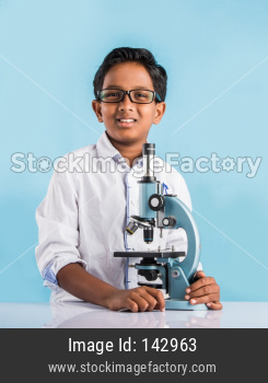 Cute little school kid studying science
