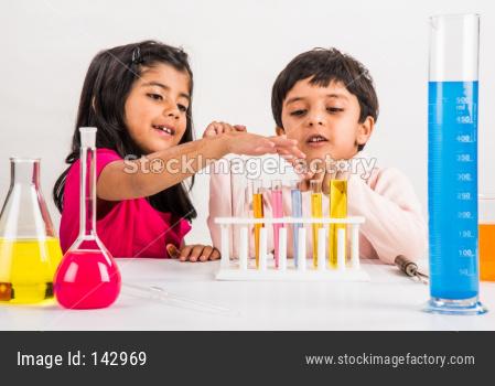 Cute little school kids studying science