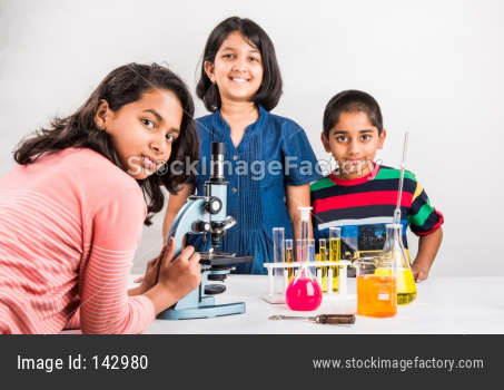 Cute little school kids studying science