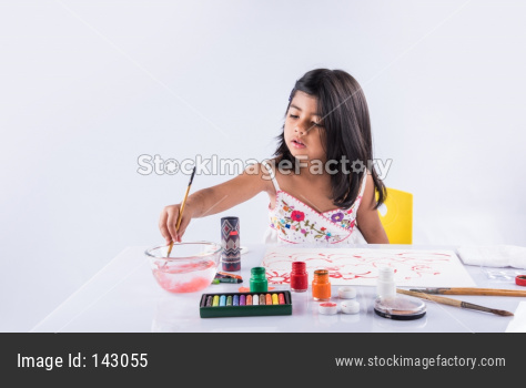 Little girl artist colouring with brush