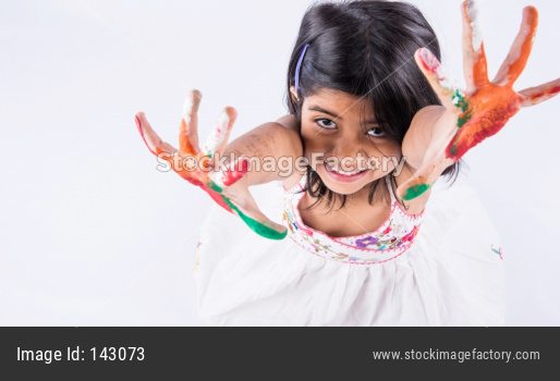 Little girl with painted palms