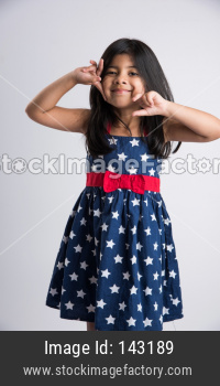Indian cute girl over white background