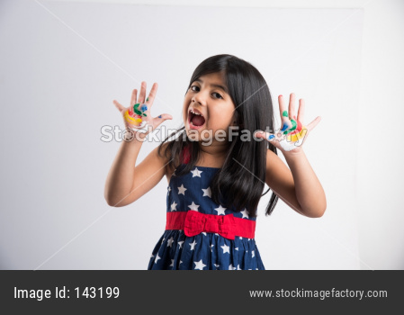 Indian cute girl with colourful palm over white background