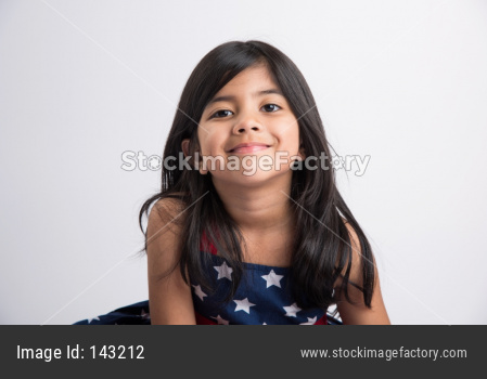Portrait of Indian small girl over white background