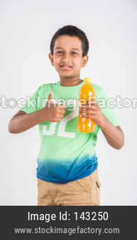 Cute little boy drinking mango juice or cold drink / beverage