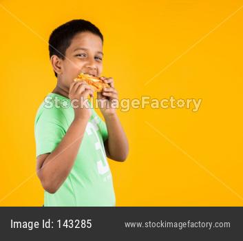 small boy child eating sandwich