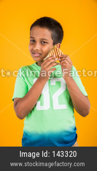 small boy child eating sandwich