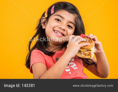 Cute little girl eating burger