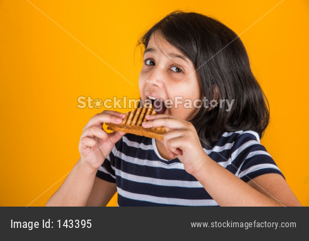 Cute little girl eating sandwich