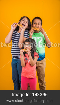 Cute little kids eating pizza