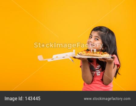 Cute little girl eating pizza