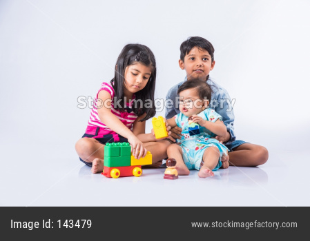Kids playing with block toys