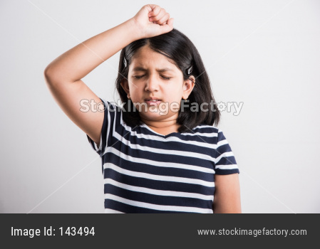 Cute little girl having headache or stressed