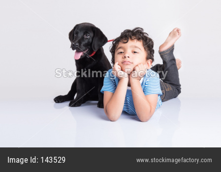 Cute little indian boy with pet dog/puppy