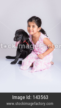 Cute little indian girl with pet dog/puppy