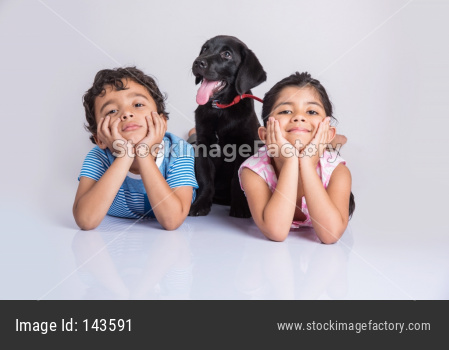 Cute little indian boy and girl with pet dog/puppy