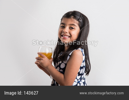 Cute little girl drinking mango juice or orange juice or cold drink