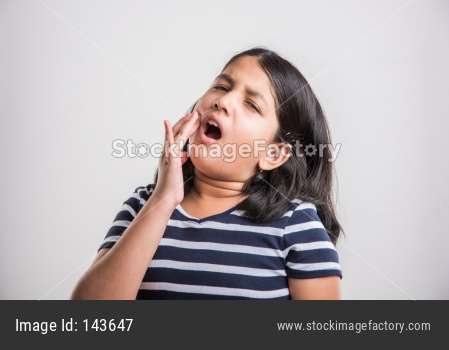 Cute little girl having tooth ache or dental problem