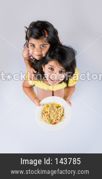 Small Girl / sisters eating chinese noodles