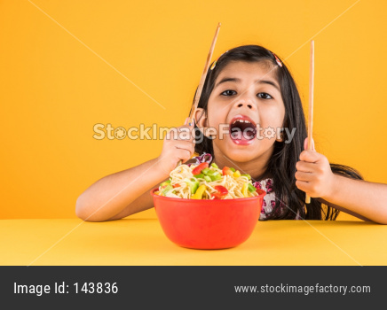 Small Girl eating chinese noodles
