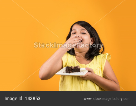 Small Girl eating cake / pastry