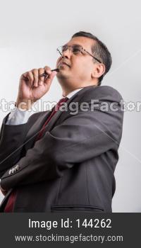 Indian handsome Businessman thinking
