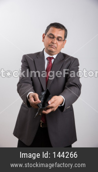 Indian handsome Businessman showing Bankruptcy or in debt