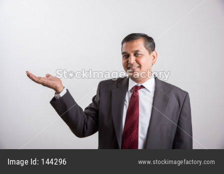 Indian handsome Businessman presenting something on blank background