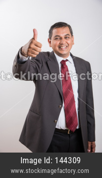 portrait of Indian handsome Businessman showing success / victory / thumbs up
