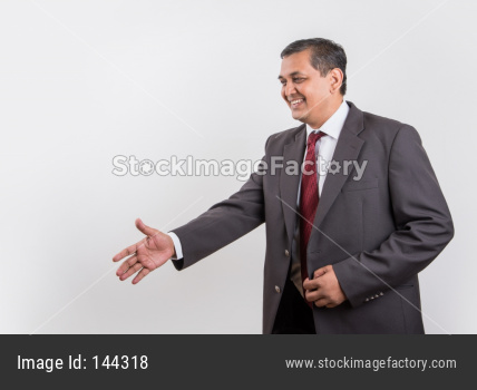 Indian handsome Businessman doing handshake