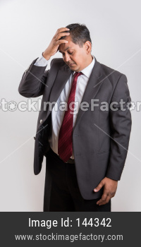 Indian handsome Businessman having headache