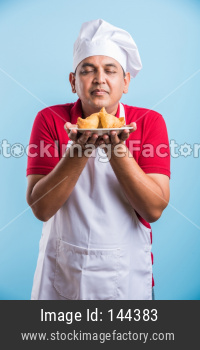 Indian Male Chef / cook in apron and wearing hat