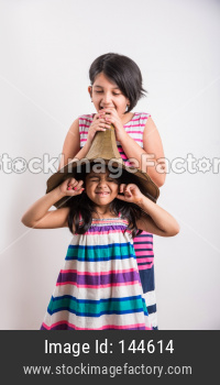 small indian girls shouting / yelling in an vintage brass gramophone speaker, isolated over white background